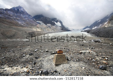 Athabasca Glacier and Columbia Ice Fields, Banff National Park, Alberta, Canada Located about an 1-1/2 hour drive north of Lake Louise. Glacier was near this point in the year 2000.  - stock photo
