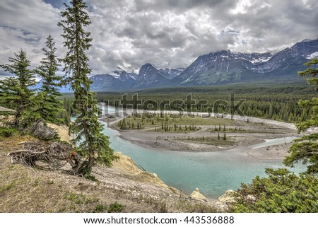 Athabasca River flowing through the Rocky Mountains - Jasper National Park, Alberta, Canada - stock photo