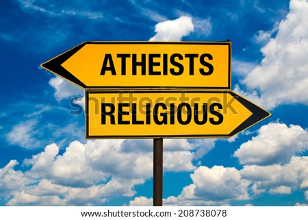 Atheists versus Religious concept. Direction signs pointing to different sides. - stock photo