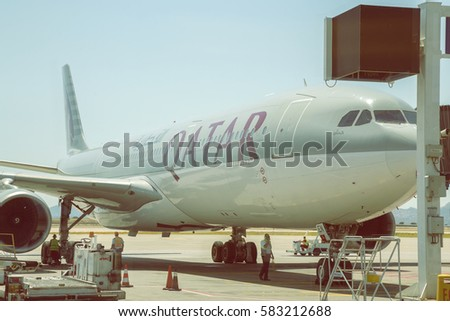 ATHEN, GREECE - JULY 24, 2016: Qatar plane at Athens International Airport, aircraft docked at the gate. Vintage style.