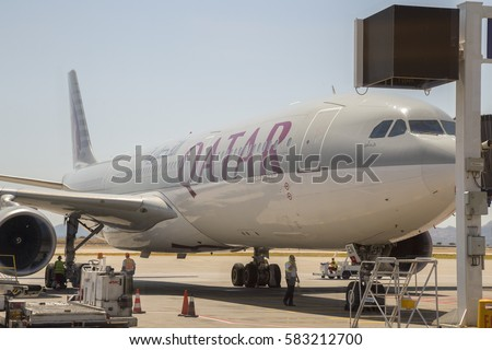 ATHEN, GREECE - JULY 24, 2016: Qatar plane at Athens International Airport, aircraft docked at the gate.