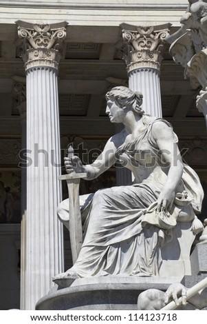 Athena Fountain and Austrian Parliament in Vienna - stock photo