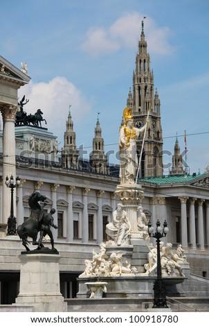 Athena Fountain, the Austrian Parliament and Vienna City Hall (Rathaus) - stock photo
