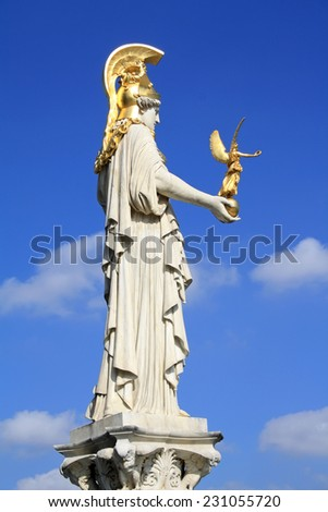 Athena statue in front of parliament in Vienna - stock photo