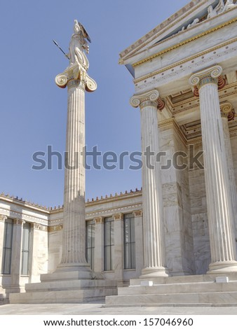 Athena the ancient Greek goddess of science and wisdom, in front pf Athens academy, Greece