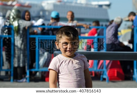 Athens – APRIL 17:  Little Syrian boy on a background of Syrian refugees in the Greek port   April 17, 2016 in Athens.