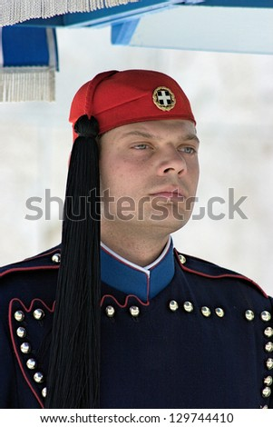 ATHENS, GREECE - APRIL 30: Evzone (presidential guard) at the monument of Unknown Soldier in front of the Greek Parliament Building at Syntagma Square on April 30, 2007 in Athens, Greece.