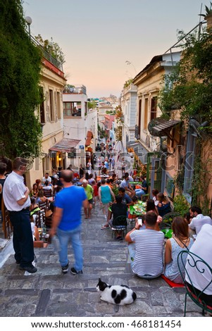 Athens, Greece - August 08, 2016: People having drinks in the old town of Plaka.