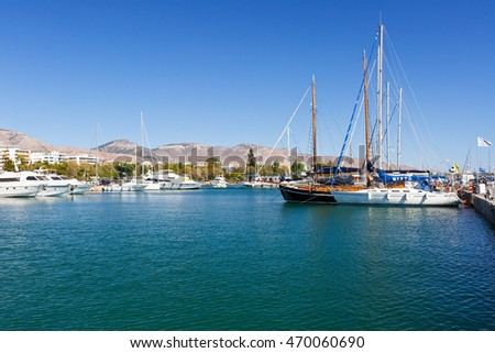 Athens, Greece - August 16, 2016: Sail boats in Alimos marina and Himettus mountains in the bacground.