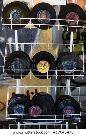 ATHENS, GREECE - AUGUST 4, 2016: Vinyl singles of greek music from the 1960s and 1970s. Scratched old used records for sale.