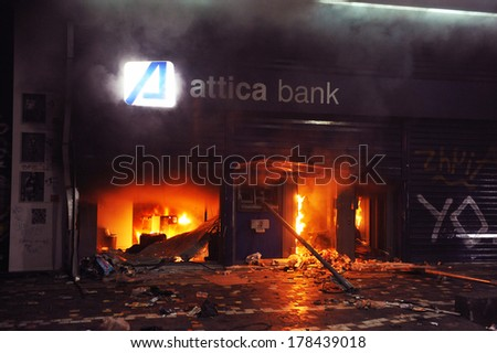 ATHENS, GREECE DEC. 02. Greek economic crisis. Banks, historical buildings, cafes and shops went up in flames, when in the parliament government vote for more income cuts, in Athens, December 02, 2012