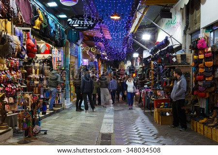 Athens, Greece - December 04, 2015: People at  the shops of the flea market in the Monastiraki area in Plaka, Athens - stock photo