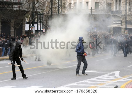 ATHENS, GREECE-FEB.23.  Protesters provoking police during demonstration in Athens, February 23, 2011. - stock photo