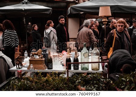 Athens - Greece, February 05, 2017. Sunday noon and the flea market downtown is open for people to do their shopping.