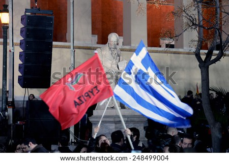 Athens, Greece Jan. 25, 2015.Supporters of Syriza left wing party with Greek blue flag and Syriza`s red outside Athens University. Syriza, won Sunday's general election.