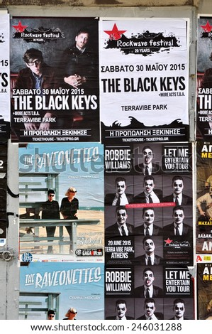 ATHENS, GREECE - JANUARY 16, 2015: City wall covered with concert posters for upcoming live music shows by The Black Keys, Raveonettes and Robbie Williams.