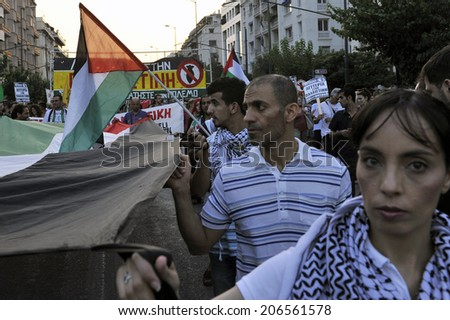 Athens Greece July 22, 2014: March of solidarity with the Palestinian people and free Gaza.  4-5 thousands of demonstrators took part in a rally to protest civilian deaths from Israeli  bombs in Gaza  - stock photo