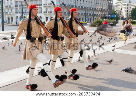 ATHENS, GREECE - JULY 1, 2006: The Changing of the Guard ceremony takes place in front of the Greek Parliament Building - stock photo