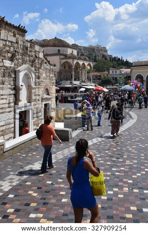 ATHENS, GREECE - JUNE 12, 2015: People walking on monastiraki square a commercial district under the acropolis. - stock photo