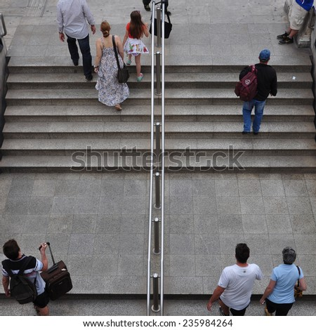 ATHENS, GREECE - JUNE 9, 2014: People walking up the stairs of Syntagma metro station. Daily life street scene in downtown Athens, Greece.