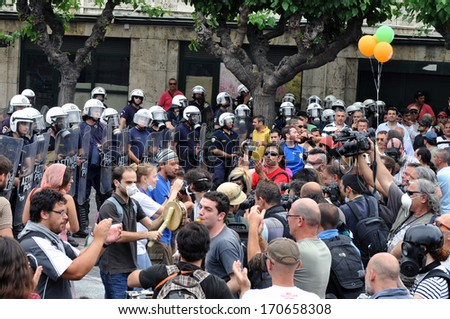 ATHENS, GREECE -JUNE 15. Protesters playing instruments in front of Greek parliament during demonstration , in Athens, June 15, 2011.
