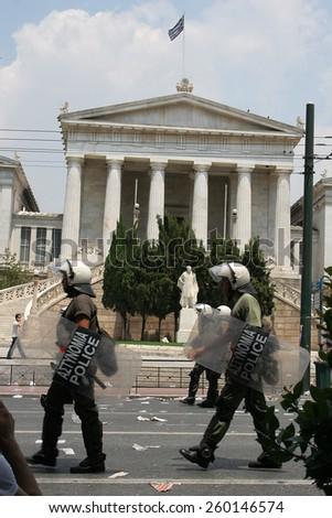 Athens, Greece - June, 22th 2006: Riot police at Athens as they march across Athens academy during a youth strike. - stock photo