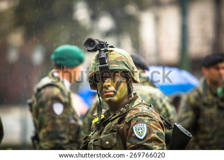 ATHENS, GREECE - MAR 25, 2015: Unidentified Greek soldier participant Military parade at national holiday - Day of National Revival Greece or Independence Day of Greece.