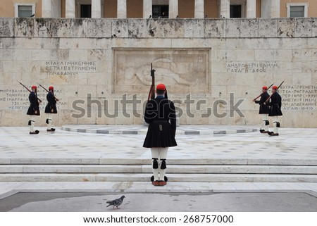 ATHENS, GREECE - MARCH 23, 2015: Every Sunday morning at 11 am, people gather in Syntagma Square to watch the official changing of the guards in front of the Parliament Building - stock photo