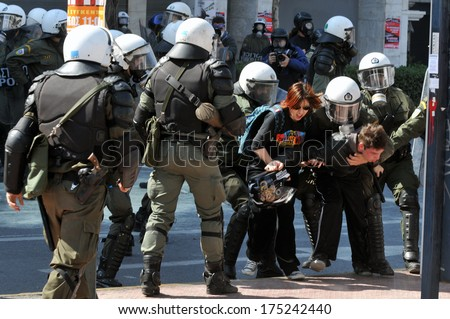 ATHENS, GREECE-March 11. Riot police arresting demonstrator, in central Athens, March 11, 2010.