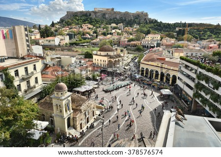 ATHENS, GREECE - OCT. 2015: Monastiraki square's aerial view. Located on Ermou Street, this is a flea market in the old city of Athens, Greece. The Acropolis is in the top background. - stock photo