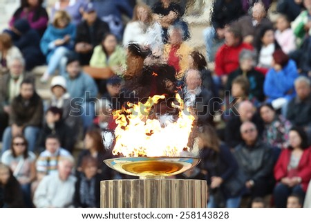 ATHENS,GREECE,OCT 5,2013:The Olympic flame was handed to organizers of the Sochi Winter Olympics 2014. The ceremony took place at the site of the first modern summer games, the Kallimarmaro Stadium - stock photo