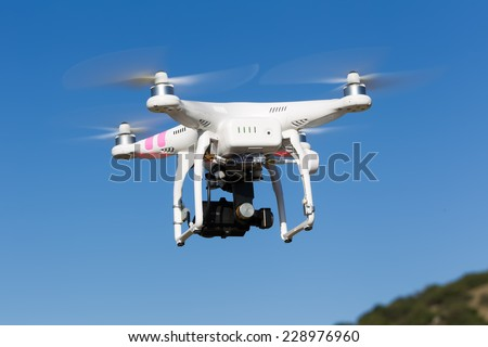 ATHENS, GREECE- OCTOBER 12, 2014: DJI Phantom drone in flight with a mounted GoPro Hero3+ Black Edition digital camera in Athens, Greece. DJI Industries produces unmanned aircraft for surveillance - stock photo