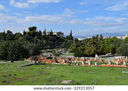 ATHENS, GREECE - OCTOBER 14, 2015: People visiting the ancient agora archaeological site and the ruins of the temple of hephaestus.