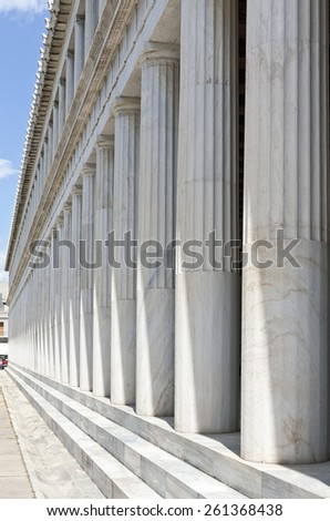 ATHENS, GREECE ON APRIL 14. View of the marble columns at Stoa of Attalos on April 14, 2011 in Athens, Greece. The Stoa is a covered walkway in the Agora. Unidentified people at the end.