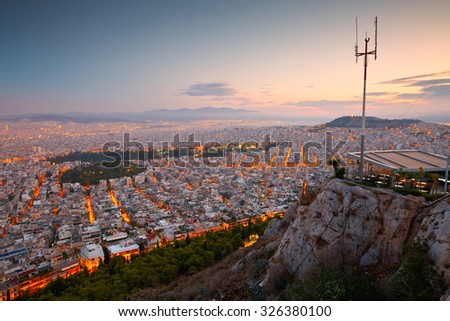 Athens, Greece - September 24 2015: Coffee shop on the top of Lycabettus Hill and view of Athens, Greece.