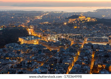 Athens skyline aerial view in the afternoon with the lights over blue hour, the Parthenon is visible  - stock photo