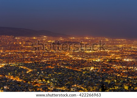 Athens skyline view after sunset with vivid street lights in Greece