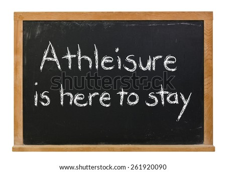 Athleisure is here to stay written in white chalk on a black chalkboard isolated on white - stock photo