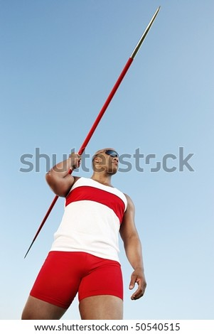 Athlete about to throw javelin, half length - stock photo