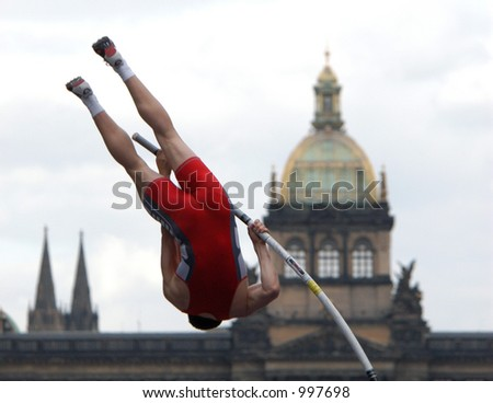 Athlete clearing the bar during a pole vault event in Prague, Czech Republic - stock photo
