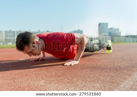 Athlete doing Push-ups - stock photo