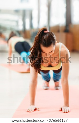 athlete doing push ups on  workout