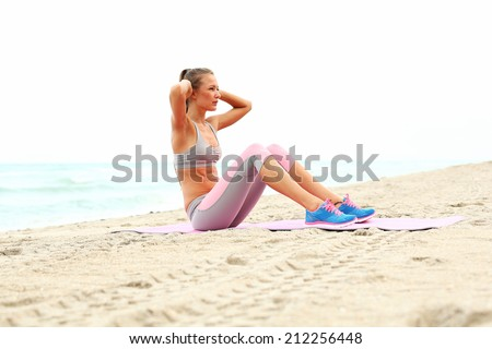 athlete girl working out her abs. - stock photo