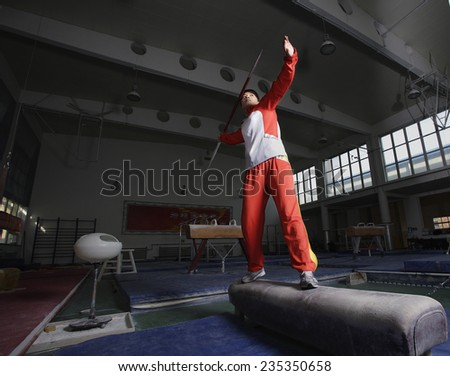 Athlete Holding Javelin in Gym - stock photo