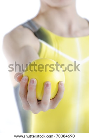 Athlete holding shot put on a white background.