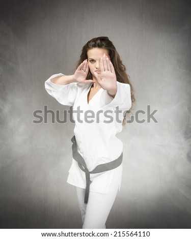 athlete in a cloud of fog ready for fighting