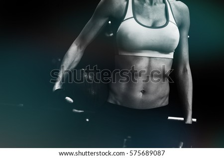 Athlete in black and white at the gym during a workout. Exercise and fitness for an active lifestyle.
