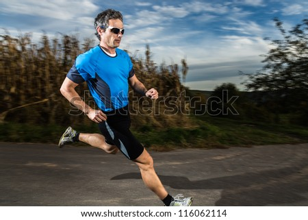 athlete is jogging - stock photo