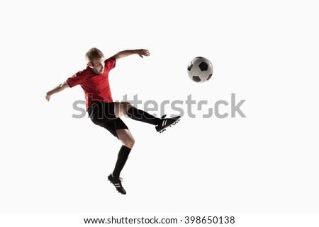Athlete kicking soccer ball - stock photo