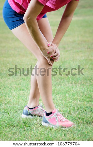 Athlete knee pain. Leg lesion after running. Unrecognizable model. - stock photo